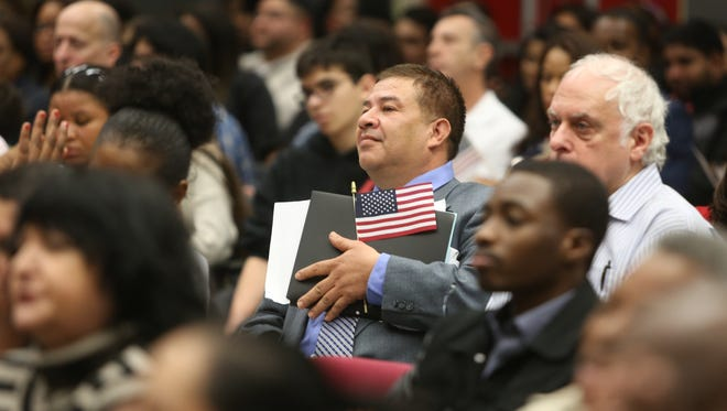 Reginaldo Umana, a Guatemala immigrant from Nanuet, at a naturalization ceremony in Pomona in February. More than 360,000 foreign-born residents like Umana have become part of the everyday fabric of the Lower Hudson Valley.