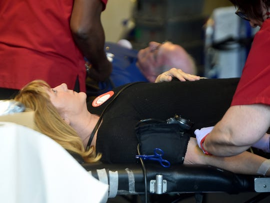 Stacey Wilson, of Simi Valley, relaxes as she gives blood during an American Red Cross blood drive at the Ronald Reagan Presidential Library & Museum on Monday.