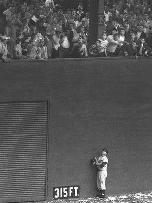 Dodgers left fielder Andy Pafko leans against the wall at the Polo Grounds watching Bobby Thomson's game-winning homer go out on Oct. 3, 1951.