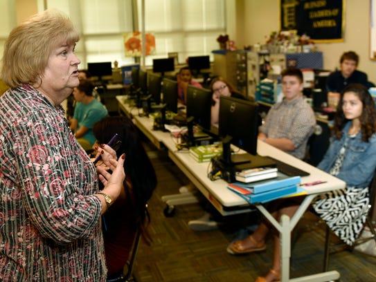Teacher Kathy Jo Reinsmith, left, talks to students