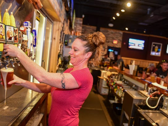 Bartender Kim Staker draws a craft ale made by Thunderhead
