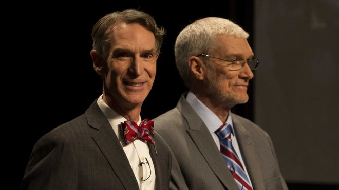 Bill Nye the Science Guy, left, and Creation Museum founder Ken Ham look on after shaking hands before their debate on evolution vs. creationism at the Creation Museum on Feb. 4.