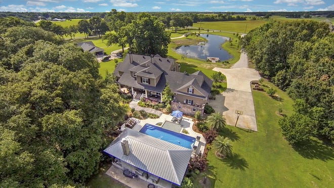 An aerial view shows the spraling 3.8 acre estate with amazing views.