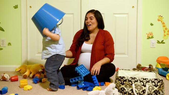Jessica Wililiams and her son, Bradley, 18 months, play before dinner. Williams delivered Bradley via an unplanned and unwanted C-section and is planning on a vaginal birth for her current pregnancy.