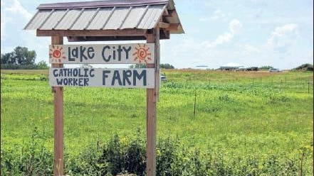 (Steve Gardiner / Forum News Service)The food and drink stand is seen under the tent in the distance at the Catholic Worker Farm is located about five miles west of Lake City on Goodhue County 5.