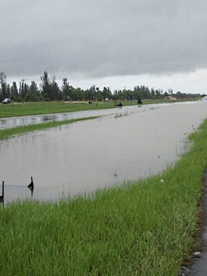 Torrential rains in the region caused flooding along a new road being built on Burnt Store Road in Cape Coral.