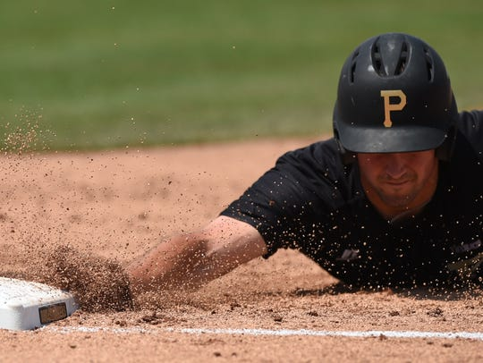 Purdue outfielder Ben Nisle dives for first to avoid