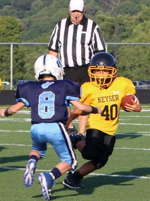 The Keyser Mini Tornado and Frankfort Colts are shown squaring off in regular season action in 2019. Tribune photo by Chapin Jewell