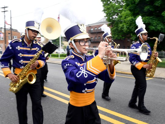 The Garfield High School marching band performs on Midland Avenue during Garfield's annual Memorial Day Parade on Sunday, May 27, 2018.