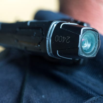 Surprise police officers use a camera made by Taser and worn on their uniforms to record interactions with the public.