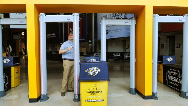 David Chadwell, VP of Event Operations, shows how the new metal detectors that have been installed at Bridgestone Arena work. It is just one of the renovations made during offseason.