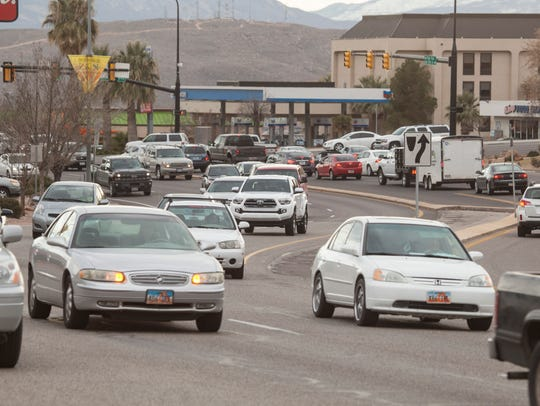 Commuters travel on Red Cliffs Drive during peak traffic