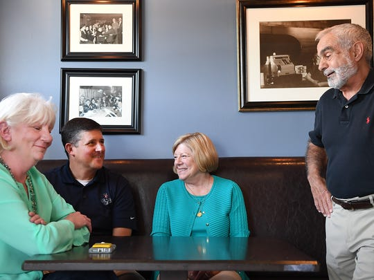 From left, Molly Kissel Patrick, Chris Kunisch, Judy Bruinooge and Vince Barra of Allendale share memories of James Comey, whom President Trump dismissed as FBI director earlier this month, at the Allendale Bar & Grill. Comey grew up in town and attended Northern Highlands Regional High School.