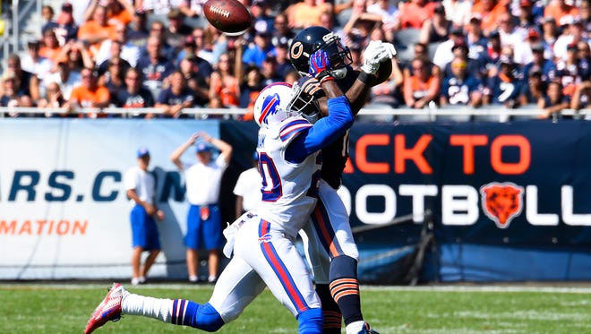 Chicago Bears wide receiver Micheal Spurlock (18) attempts to make a catch against Buffalo Bills cornerback Corey Graham (20) last week. Graham, a Buffalo native, is happy with the Bills' recent sale.