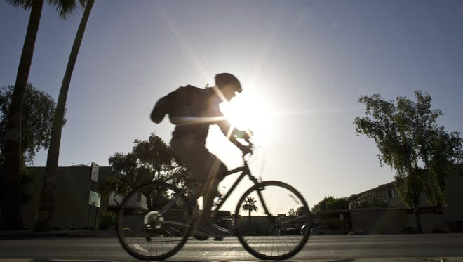 A Scottsdale Bike to Work Day rider makes down way down Miller Road in 2008.