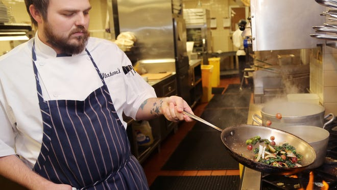 Chef Brandon Frohne sautes kale, grapes and fennel in the kitchen at Mason's in the Loews Vanderbilt Hotel. Frohne and the hotel parted ways on Aug. 6.