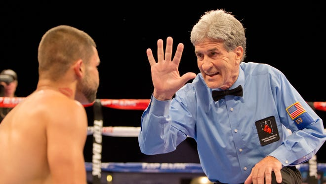 Referee Vic Drakulich gives Andres Tapia a standing eight count in the Super Bantamweight division of the 2015 Rural Rumble in Fallon.