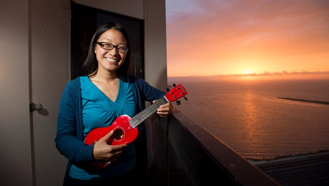 Esther Yeh, a 29-year-old optometrist in Emeryville, Ca., holds a ukulele that she received through Yerdle. Yeh says the instrument is her favorite acquisition from Yerdle, a website that lets users give and receive free items.