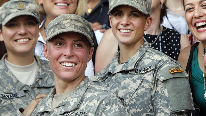 Army 1st Lt. Shaye Haver, center, and Capt. Kristen Griest, right, in August became the first female graduates of the Army's rigorous Ranger School.