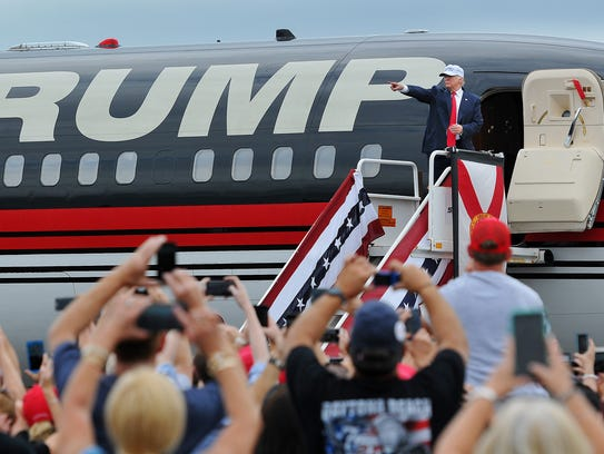 Donald Trump greets supporters at the Lakeland Linder