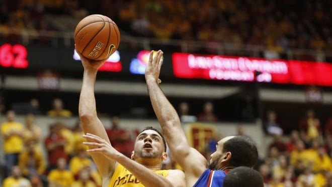 Iowa State forward Georges Niang (31) shoots over Kansas forward Perry Ellis (34) Monday, Jan 25, 2016, during the Cyclones' 85-72 win at Hilton Coliseum in Ames, Iowa.