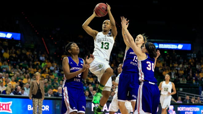 Baylor Bears forward Nina Davis (13) shoots past Northwestern State Lady Demons guard Beatrice Attura (30) during the second half at Ferrell Center.