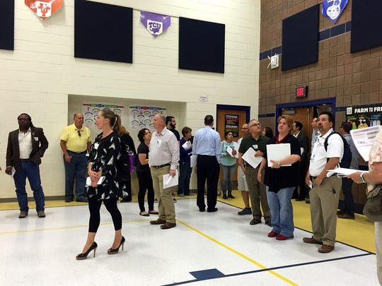 El Paso Independent School District Facilities Advisory Committee members enjoy the large, air-conditioned gym at Hart Elementary School, which opened in 2014.
