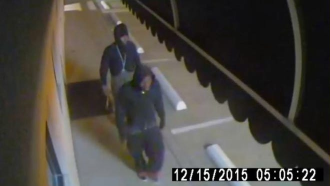 Surveillance footage captured images of the two men accused of breaking in to and stealing from two businesses, and attempting to do the same at a third.