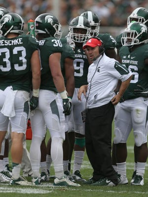 Michigan State co-defensive coordinator Mike Tressel talks with players during first half action against Air Force on September 19, 2015.