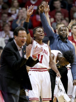 Hoosiers guard Yogi Ferrell (11) and the rest of the bench celebrate during an IU win, Jan. 10, 2016.