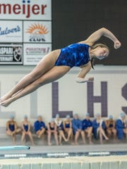 Harper Creek's Megan Kusler competes in the diving
