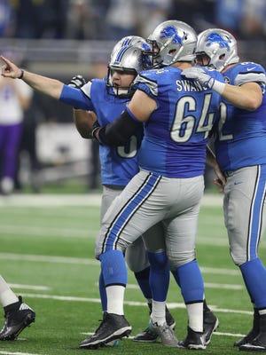 Lions kicker Matt Prater, left, celebrates his winning 40-yard field goal as the clock expires to beat the Minnesota Vikings on Thursday, Nov. 24, 2016 at Ford Field in Detroit.