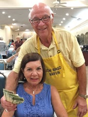 Monday Night Bingo at JCMI is played through May 7. You can win like Patricia Tozzi, above, with Bingo committee member Marvin Klein.