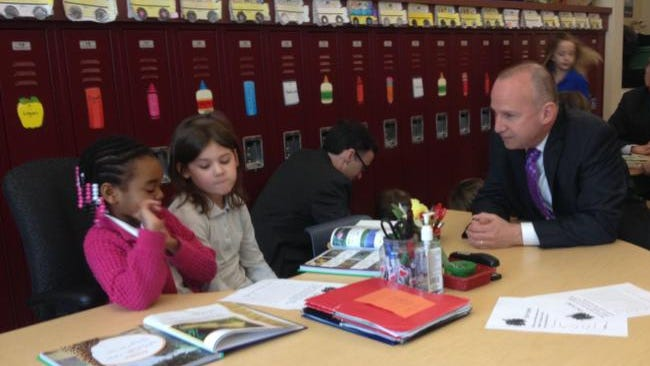 Gov. Jack Markell talks with students in a first-grade English class at Lancashire Elementary School on Monday.