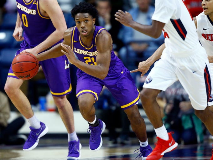 Lipscomb guard Kenny Cooper (21) drives the ball up