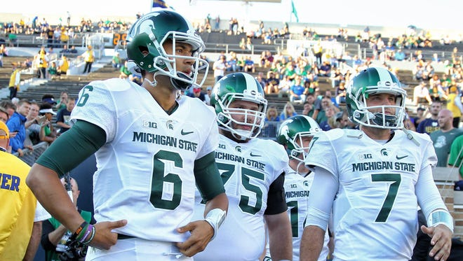 Michigan State Spartans quarterbacks Damion Terry (6) and Tyler O'Connor (7).