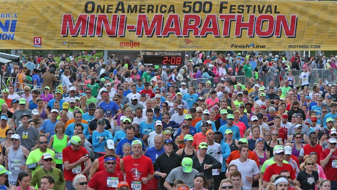 Runners start the OneAmerica 500 Festival Mini-Marathon in waves, Saturday, May 7, 2016. OneAmerica is the title sponsor of the annual race.