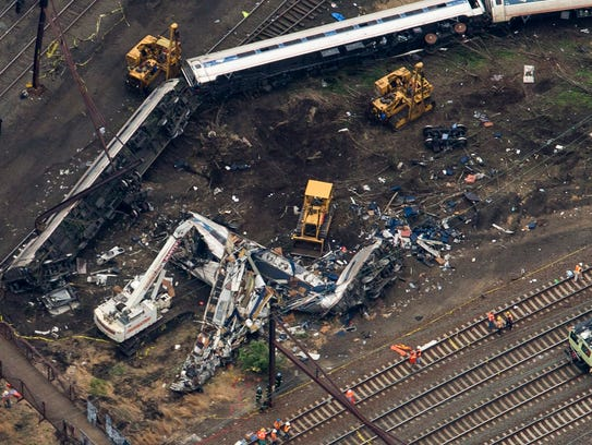 The remains of an Amtrak train that derailed on its