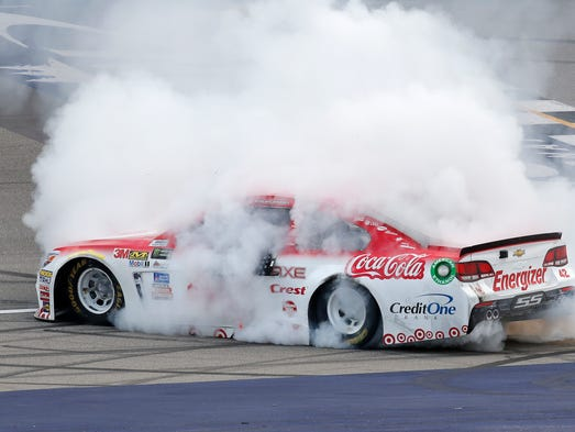 Kyle Larson celebrates winning the NASCAR Cup Series