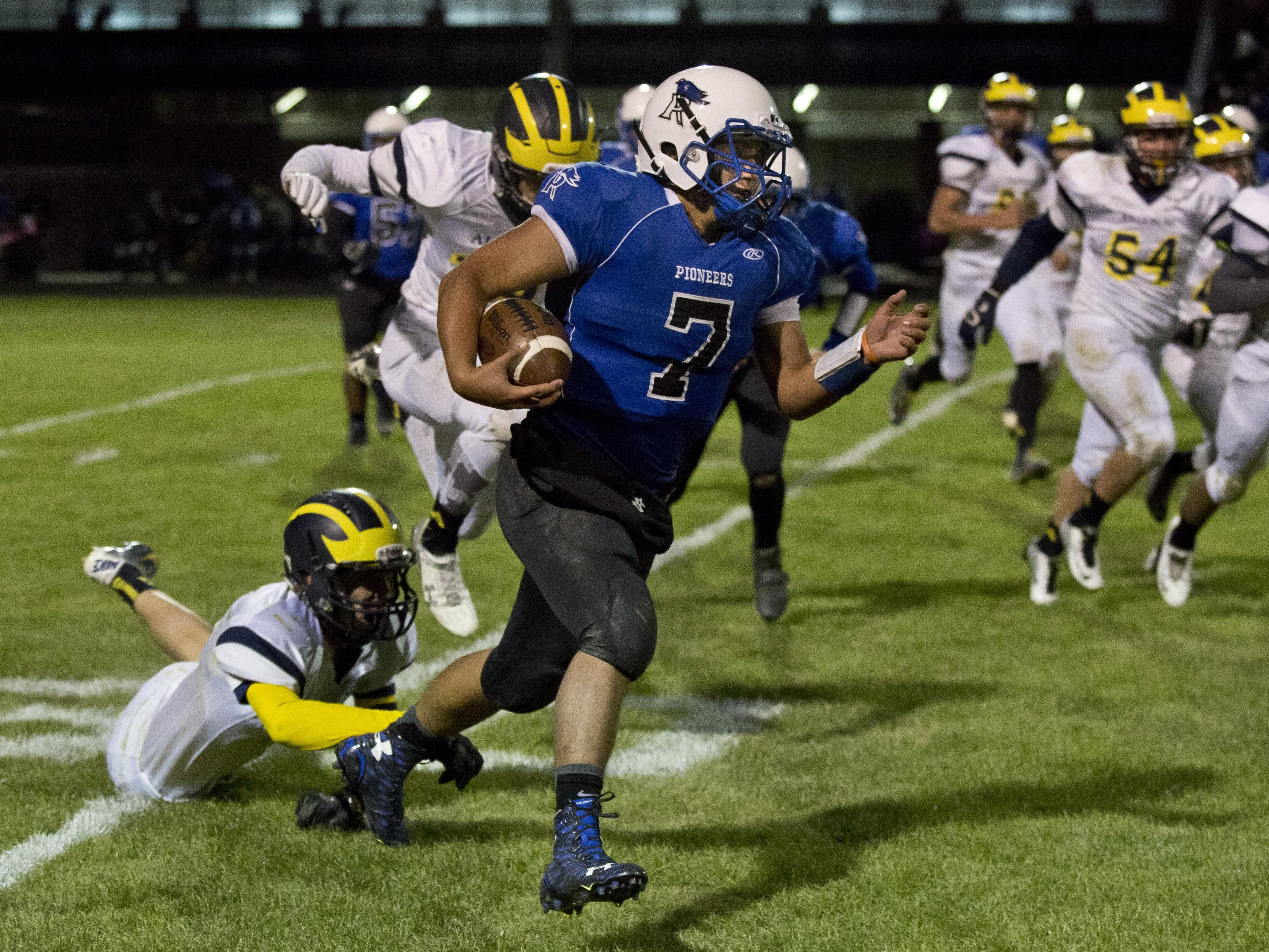 Cros-Lex's Justin Johnston runs the ball and breaks several Algonac tackles during a football game Friday, October 2, 2015 at Croswell-Lexington High School.