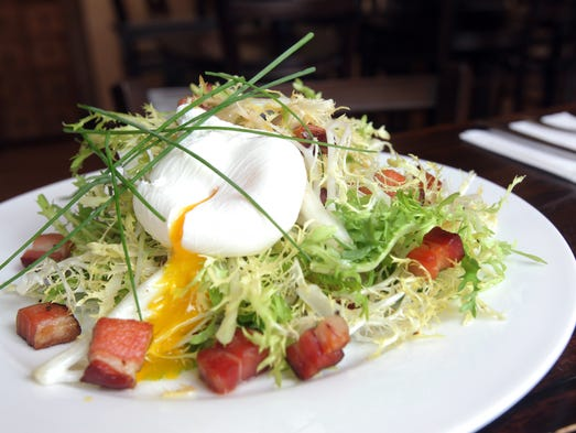 Satur Farms Frisee salad with warm bacon dressing and organic poached egg is served at Sorell Wine Bar Bistro in New Rochelle on July 1, 2014.