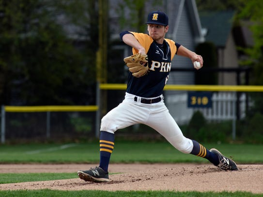 Huskies' pitcher Brett Manis tosses in a pitch Monday,