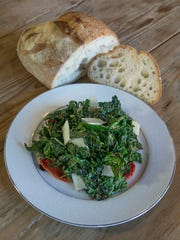 A salad of charred kale, tomato and pecorino and house-made bread at Medusa Stone Fired Kitchen in Asbury Park.