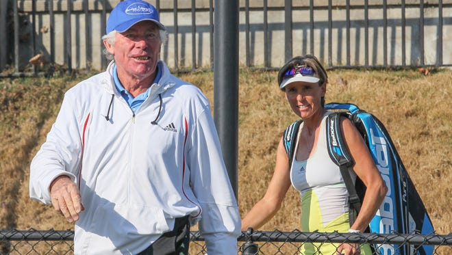Lucien Woorons, left, and his daughter Sophie Woorons, who teach tennis at Brookstone Meadows in Anderson, won a national title as a Super Senior father-daughter doubles team on a clay court in Florida.