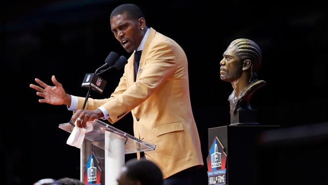 Former NFL player Randy Moss gives a speech during an induction ceremony at the Pro Football Hall of Fame, Saturday, Aug. 4, 2018, in Canton, Ohio. (AP Photo/Ron Schwane)