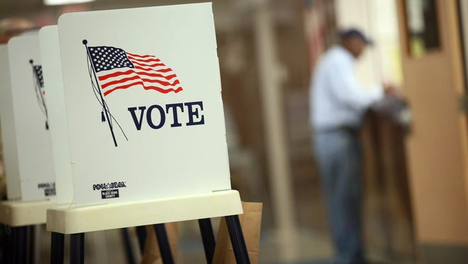 Voting booths are set up for early voting at the Black Hawk County Courthouse on Sept. 27, 2012 in Waterloo, Iowa.
