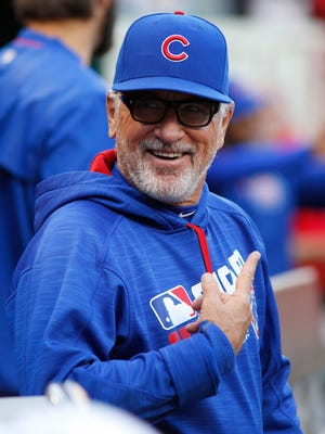 Chicago Cubs manager Joe Maddon in the dugout at the beginning of a game with the Cincinnati Reds at Great American Ball Park.