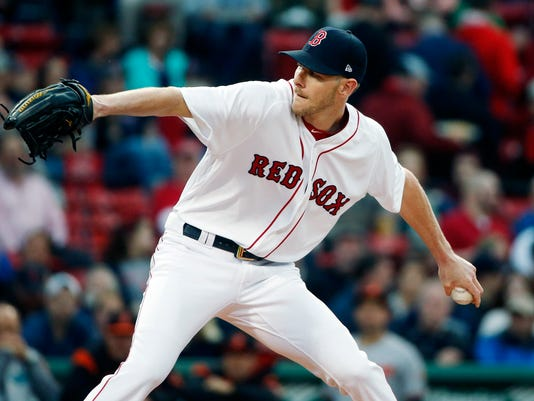 Boston Red Sox's Chris Sale pitches during the first inning of a baseball game against the Baltimore Orioles, Tuesday, May 2, 2017, in Boston. (AP Photo/Michael Dwyer)