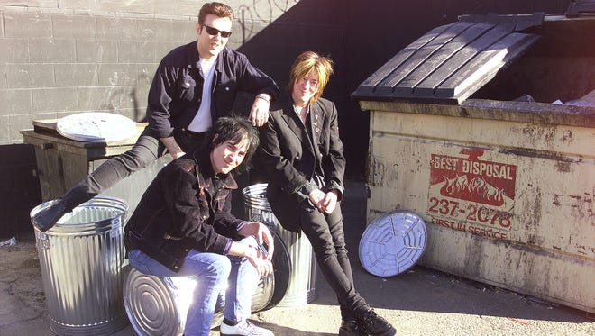 The Beat Angels, a local Phoenix group, pose in a Central Phoenix alley on Nov. 5, 1998. Indentified clockwise from top left are guitarist Keith Jackson, Vocalist Brian Smith and guitarist Michael Brooks. Photo by