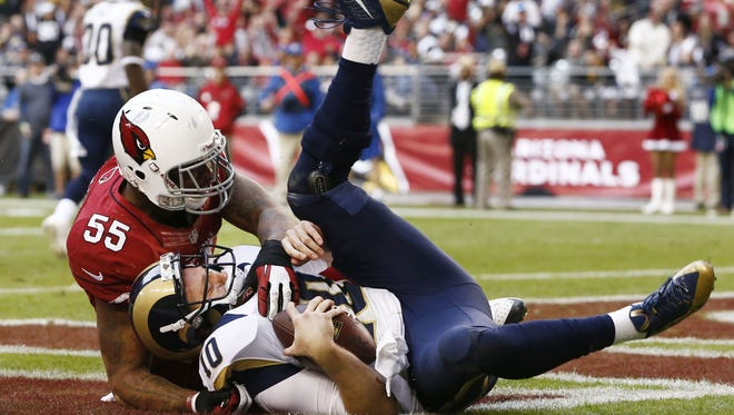 Arizona Cardinals linebacker John Abraham sacks St. Louis Rams quarterback Kellen Clemens in the end zone for a safety in the 3rd quarter on Sunday, Dec. 8, 2013 at University of Phoenix Stadium in Glendale.